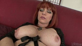 Mature redhead brickhouse Kylie Ireland gets her mouth pounded