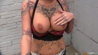 Rock and Roll babe with tattooed body gives a head