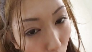 Asian milf sucks hard cock for a load of cum on her face