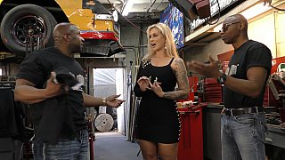 Car shop threesome with a busty girl